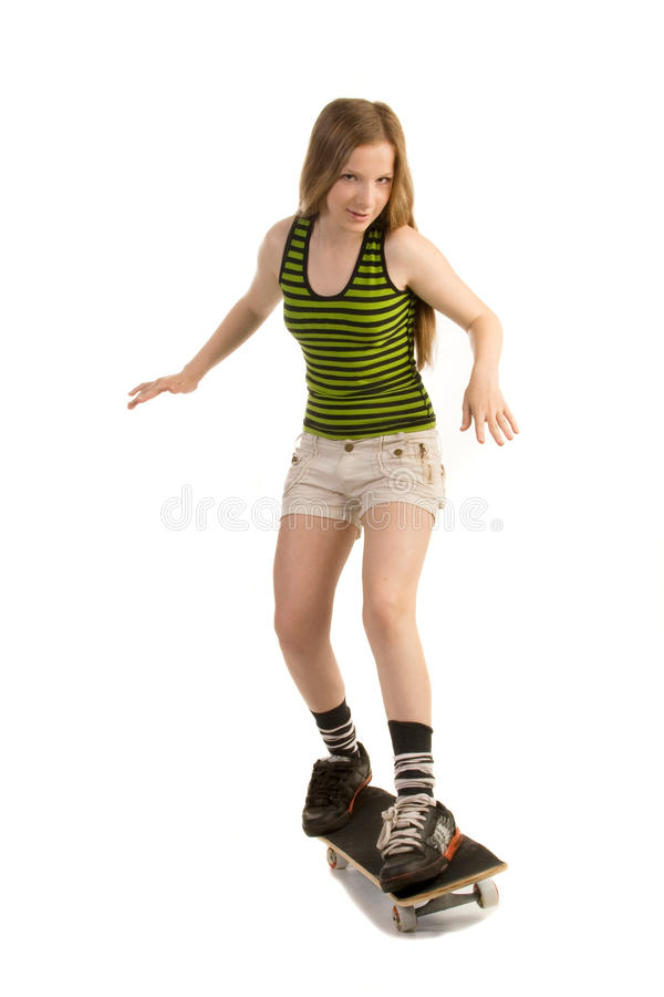 Menina alegre no skate imagens de stock royalty free