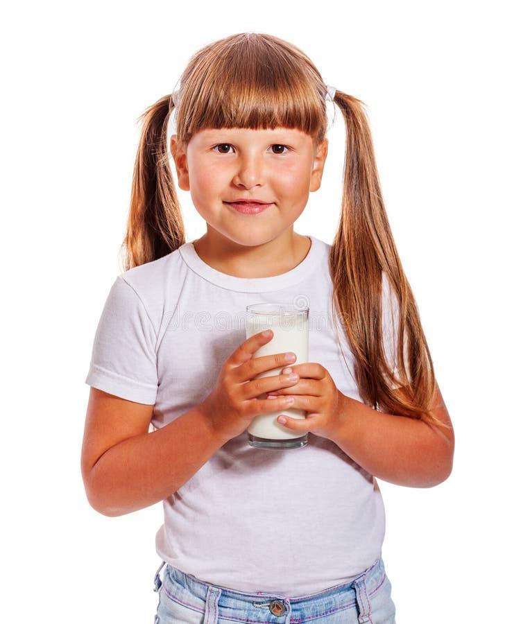 A menina ama o leite fotografia de stock royalty free