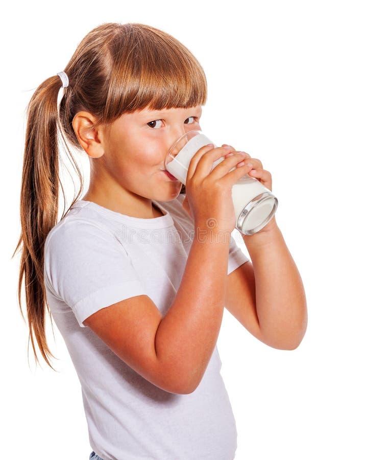 A menina ama o leite fotos de stock royalty free