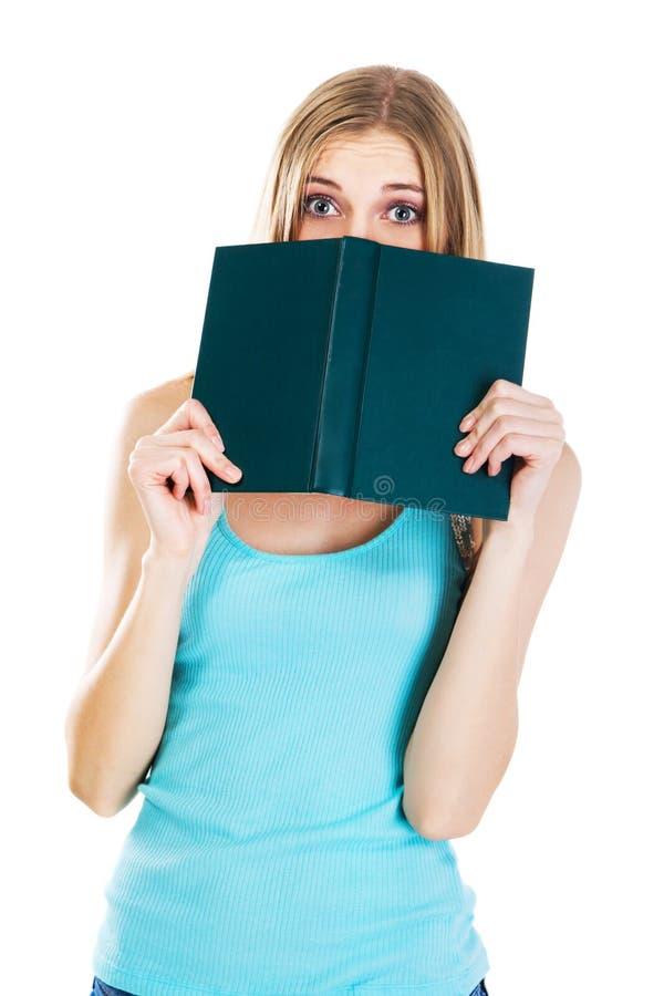 Menina amedrontada com um livro imagens de stock