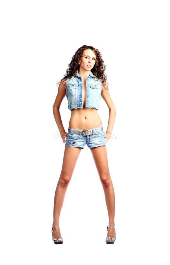 Menina amigável nas calças de brim imagem de stock