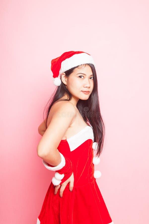 Menina asiática bonito de Santa Claus do Natal imagens de stock