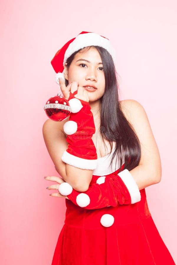Menina asiática bonito de Santa Claus do Natal imagem de stock royalty free
