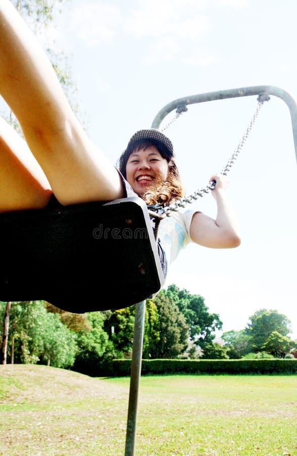 Menina asiática bonito em um balanço fotografia de stock royalty free