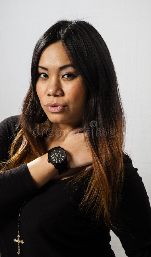 Menina asiática com bordos de Pouty imagem de stock