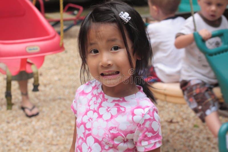 Menina asiática com face scared imagens de stock