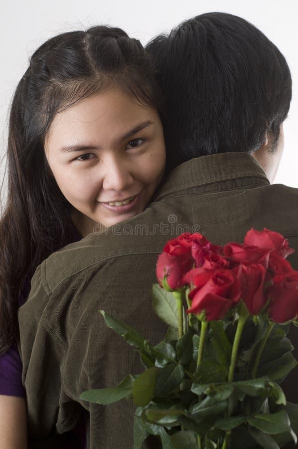Menina asiática com rosas imagens de stock