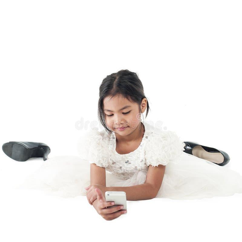 Menina asiática da criança no vestido branco isolado no fundo branco fotografia de stock royalty free
