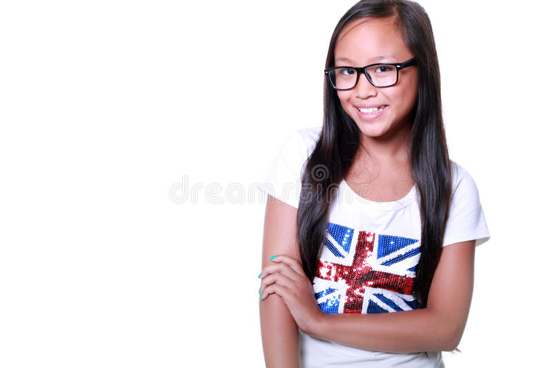 Menina asiática de sorriso nos vidros imagem de stock