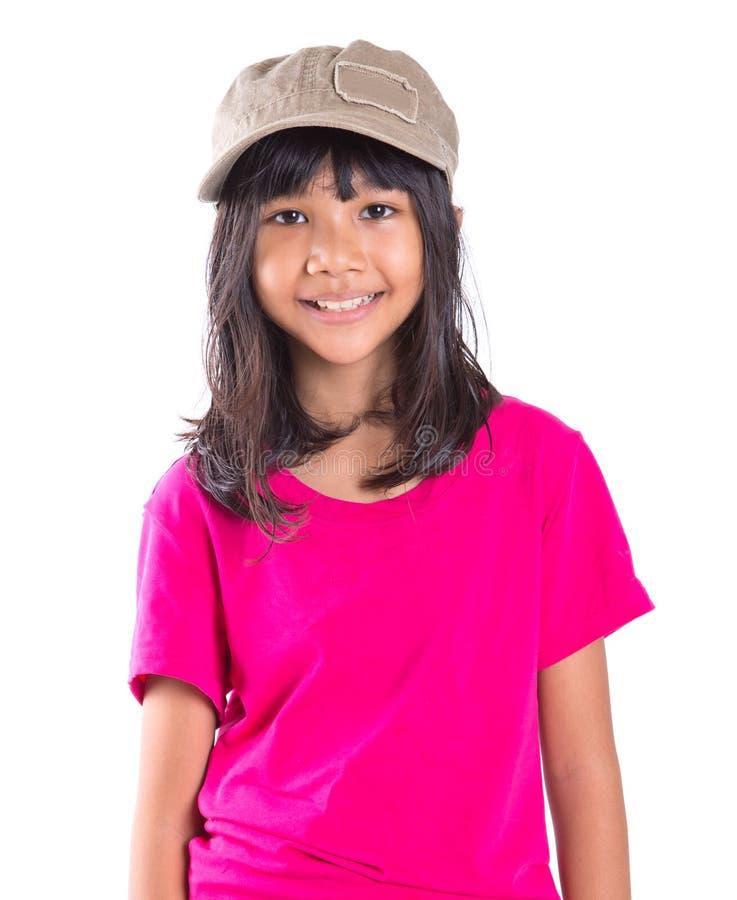 Menina asiática do Preteen novo com um tampão II imagem de stock