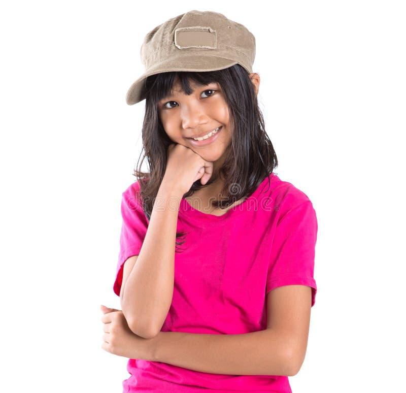Menina asiática do Preteen novo com um tampão III fotos de stock royalty free