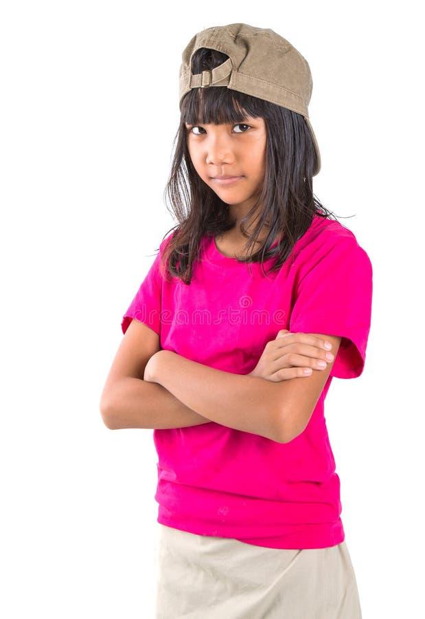 Menina asiática do Preteen novo com um tampão VII foto de stock royalty free