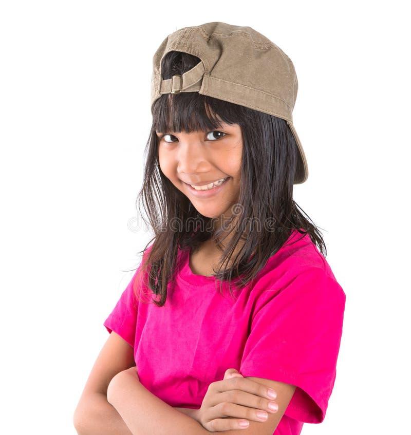 Menina asiática do Preteen novo com um tampão VIII imagem de stock