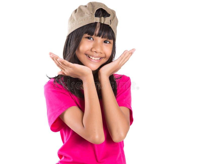 Menina asiática do Preteen novo com um tampão X imagens de stock