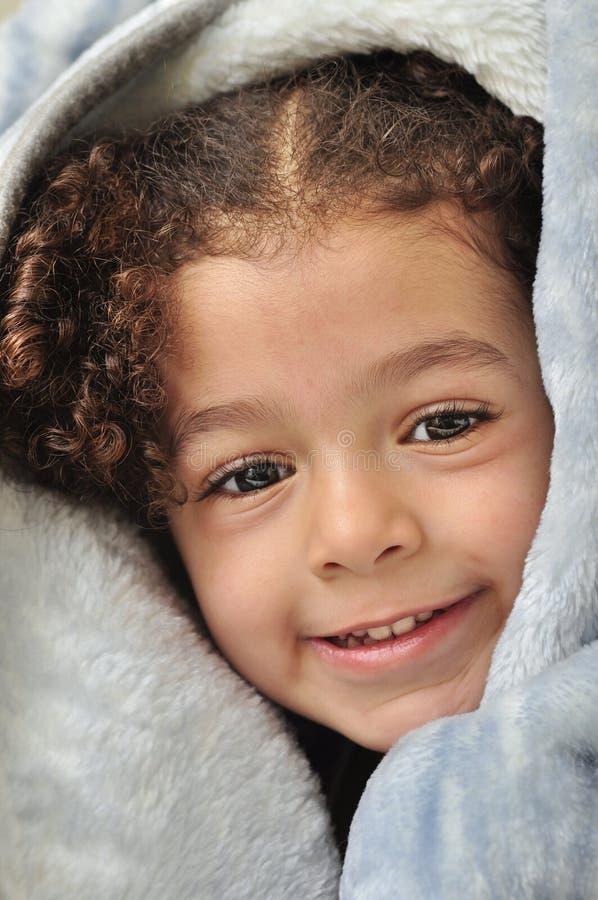 Menina Atrás Do Cobertor Fotografia de Stock Royalty Free
