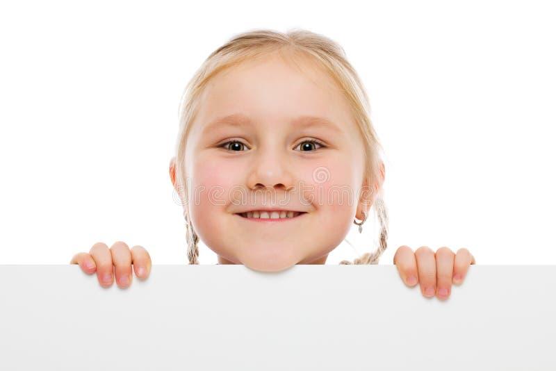 Menina atrás do whiteboard imagens de stock royalty free