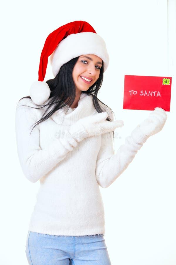 Menina atrativa das mulheres com letra de Santa fotografia de stock royalty free