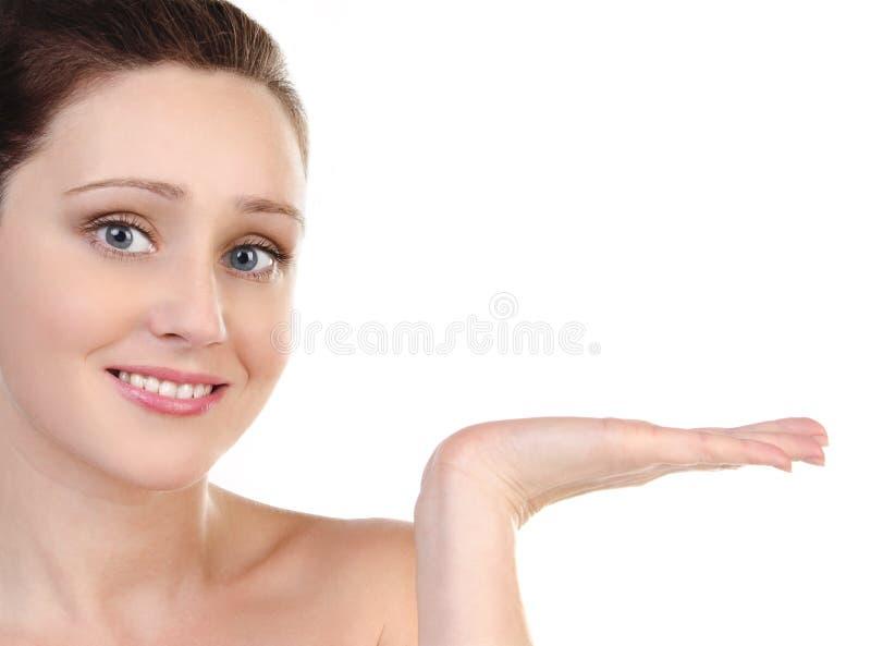 Menina atrativa de Skincare que mantem sua mão isolada foto de stock