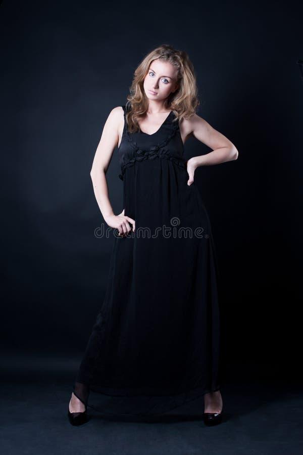 Menina atrativa em um vestido bonito imagens de stock
