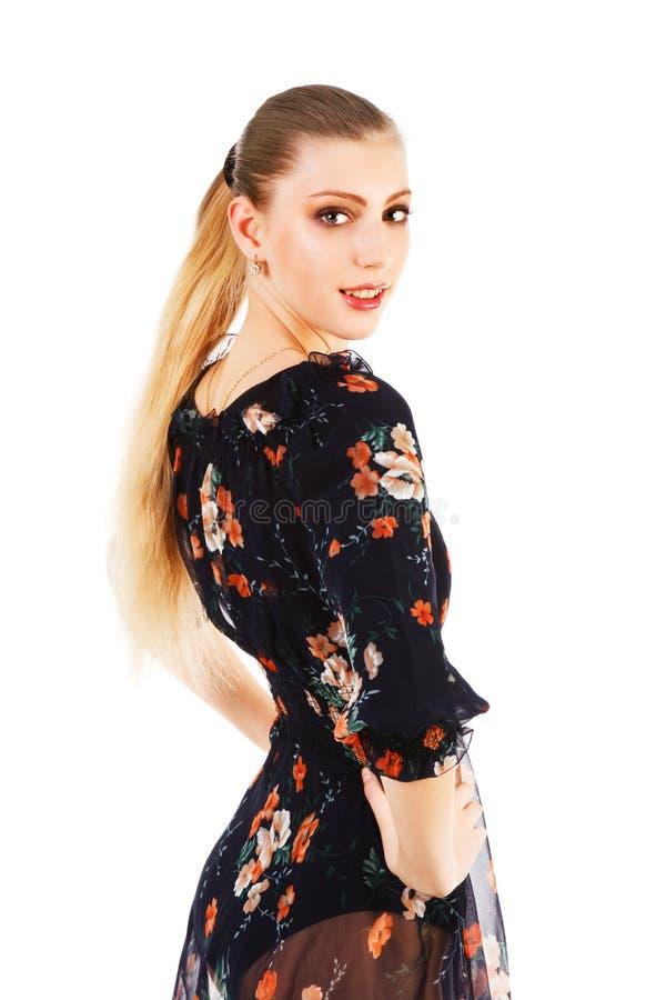 Menina atrativa nova no vestido imagens de stock royalty free