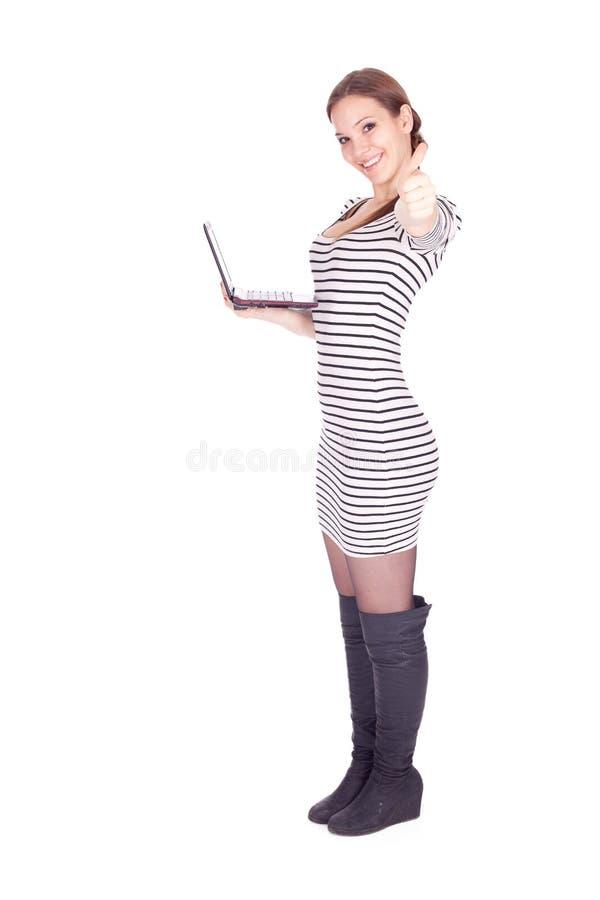 Menina bem sucedida com portátil imagens de stock royalty free