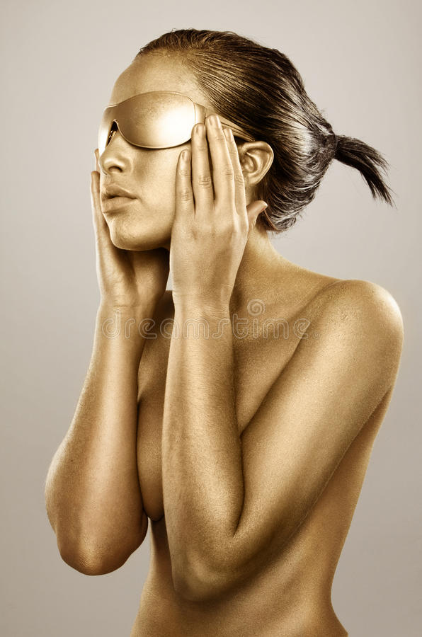 Menina bodypainted ouro fotografia de stock