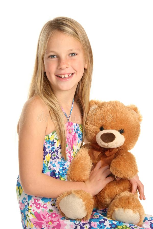 Menina bonita com animal do brinquedo foto de stock royalty free
