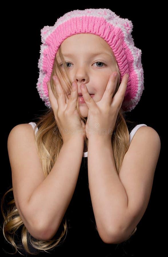 Menina bonita com mãos na face imagem de stock