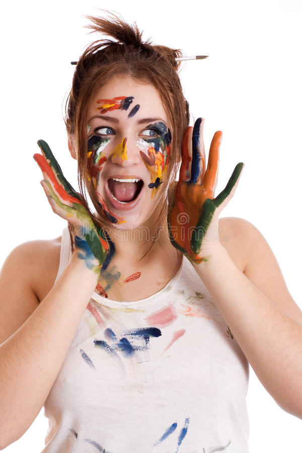 Menina bonita com mãos na pintura imagem de stock royalty free