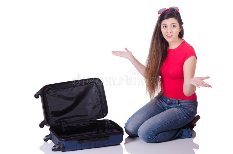 Menina bonita com a mala de viagem isolada no branco imagem de stock royalty free