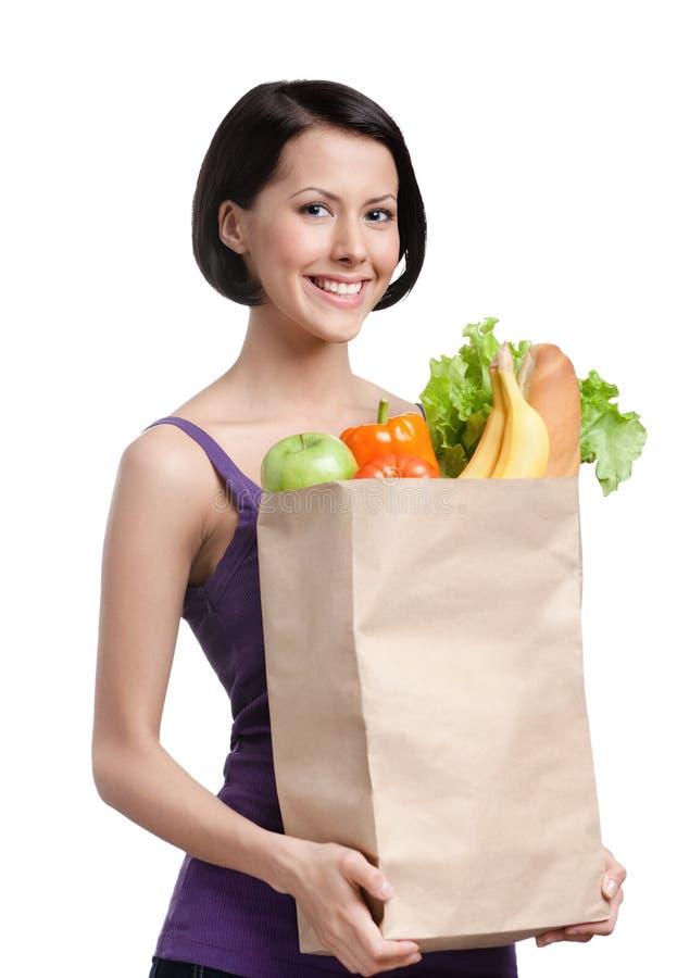 Menina bonita com o pacote de fruta foto de stock royalty free