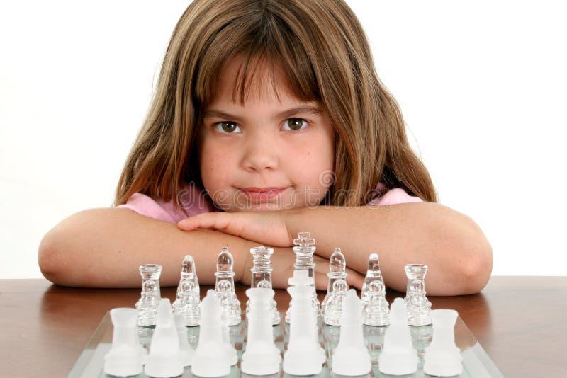 Menina bonita com placa de xadrez de vidro foto de stock royalty free