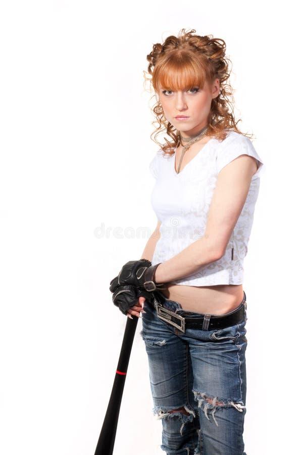 A menina bonita com um bastão fotografia de stock royalty free