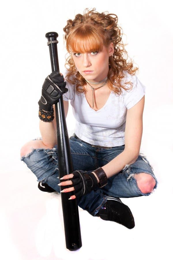 A menina bonita com um bastão imagem de stock