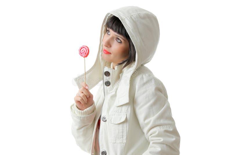 Menina bonita com um lollipop fotos de stock