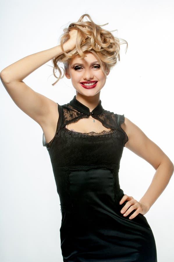 Menina bonita com um sorriso em sua cara imagens de stock royalty free