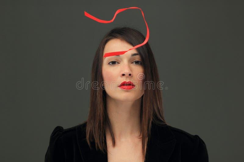 Download Menina Com Uma Tira Vermelha Imagem de Stock - Imagem de beleza, consideravelmente: 29831095
