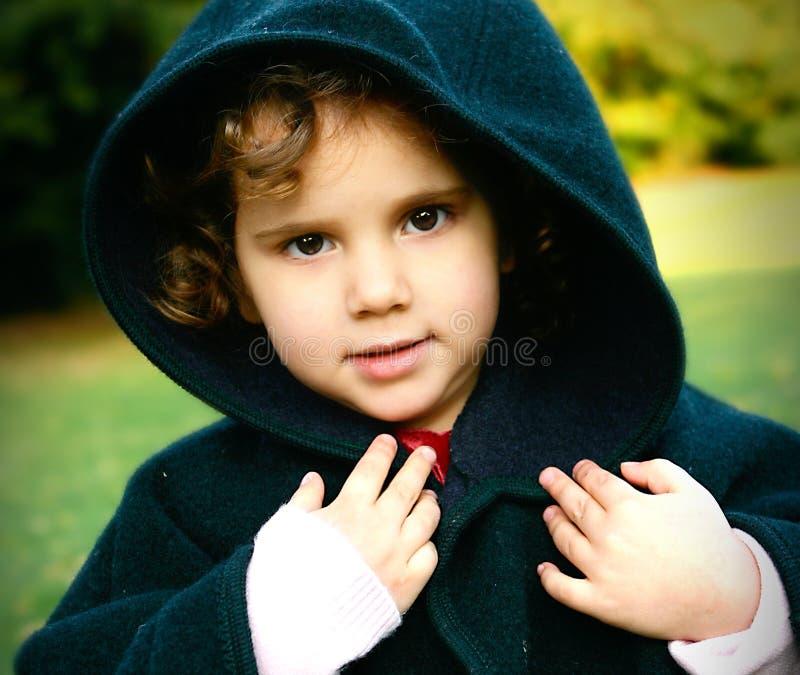 Menina bonita da criança no revestimento de lã fotografia de stock royalty free