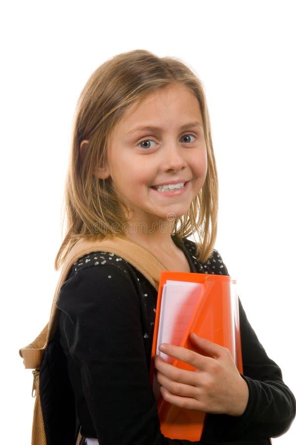 Menina bonita da escola com livros e trouxa fotos de stock royalty free