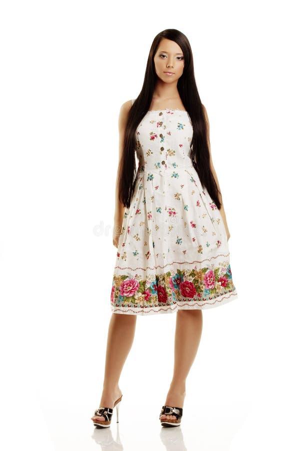 Menina bonita da vila em um vestido fotografia de stock