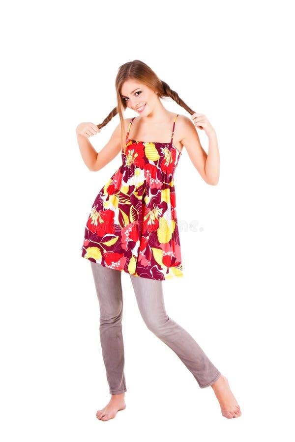 Menina bonita de sorriso dos jovens no vestido fotos de stock