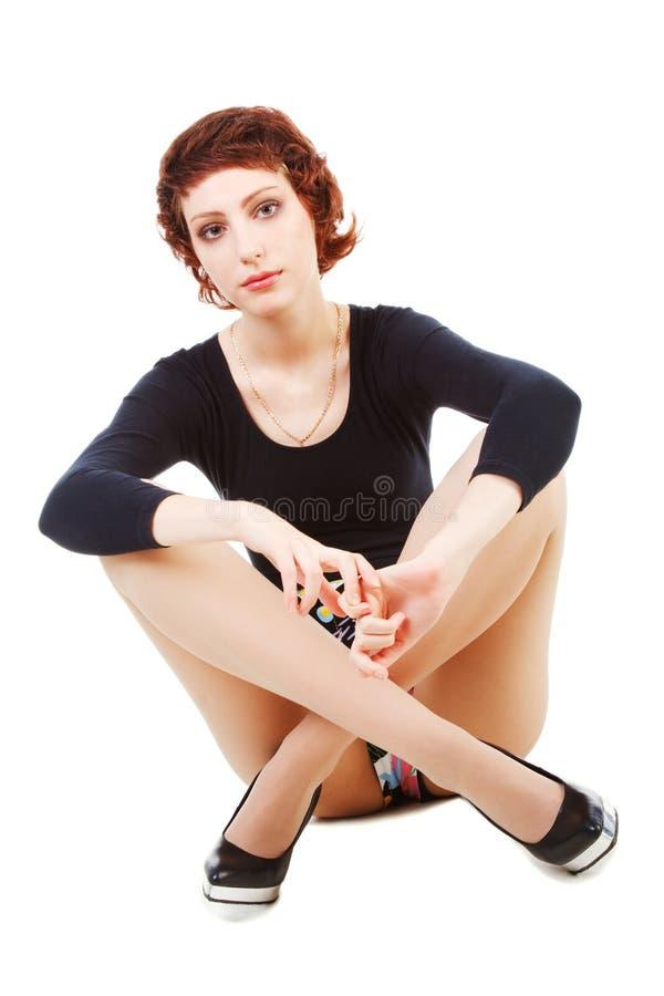 Menina bonita do divertimento novo no preto imagem de stock royalty free