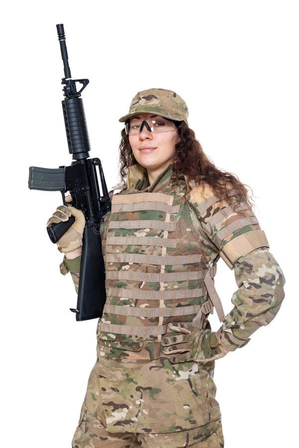 Menina bonita do exército com rifle fotos de stock