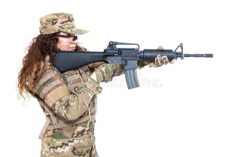Menina bonita do exército com rifle imagem de stock