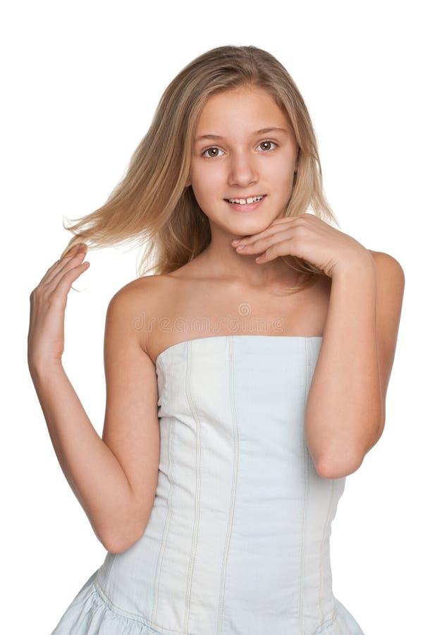 Menina bonita do preteen contra o branco fotografia de stock