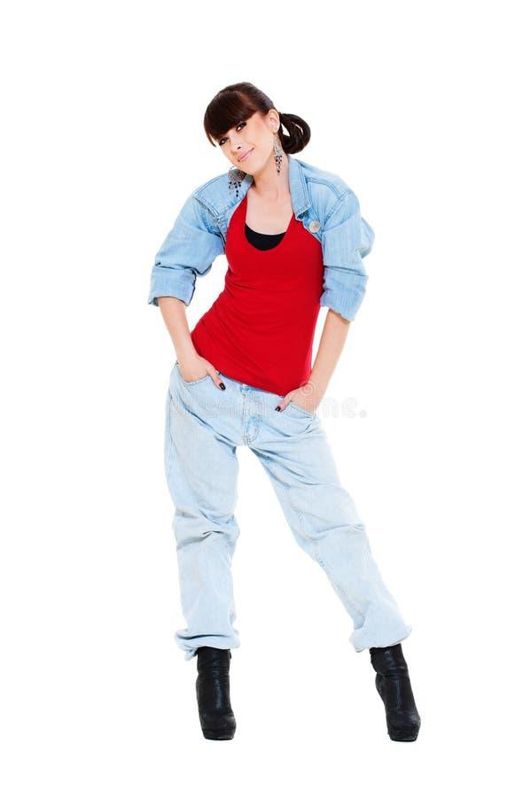 Menina bonita do smiley na calças de ganga imagem de stock royalty free