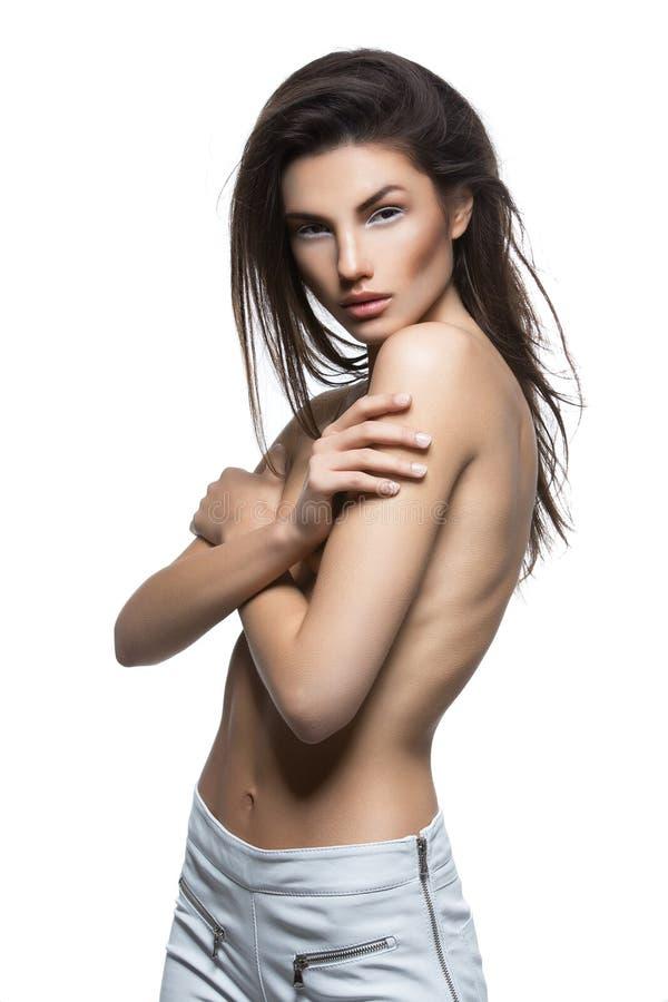 Menina bonita em calças do couro branco fotografia de stock royalty free