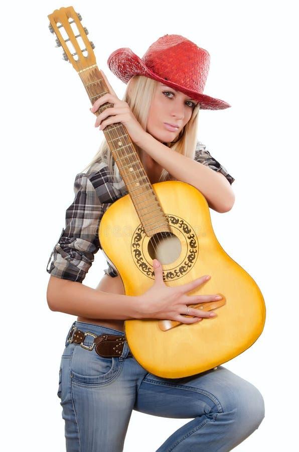 A menina bonita em um chapéu de cowboy foto de stock