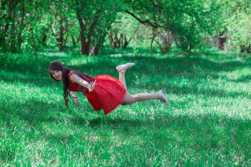 menina bonita em um vermelho fotografia de stock royalty free