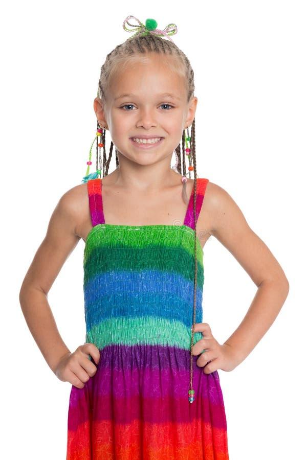 Menina bonita em um vestido colorido fotos de stock